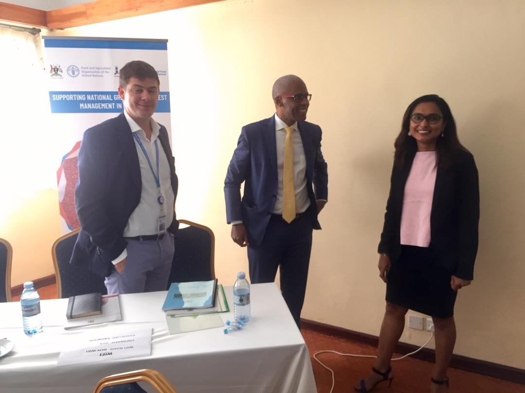 Dr Mireille Totobesola FAO Project Manager (R), Antonio Luis Evora Querido the FAO Country Representive (M), Ryan Anderson the deputy Country Director WFP Uganda at the validation of National Post Loss management strategy in Kampala on May 30.