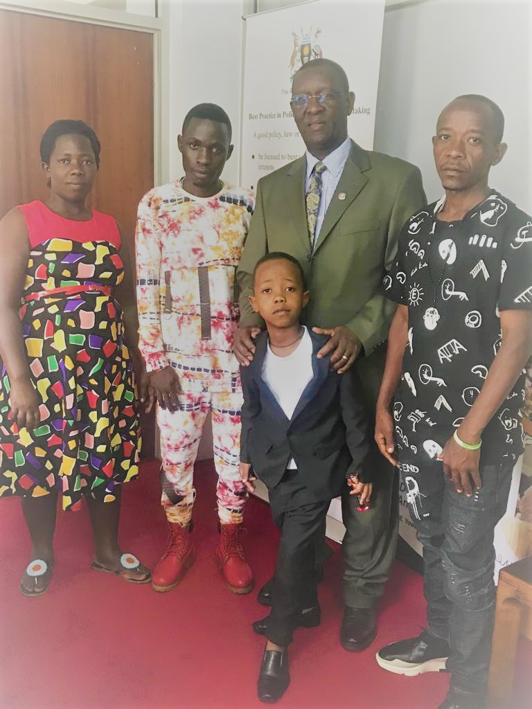 L-R; Mother, manager, PS Bigirimana holding Fresh Kid and Father at PS's office in Kampala on Thursday. (COURTESY PHOTO)