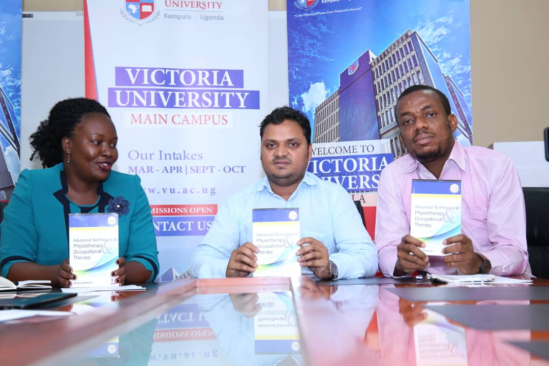(LR-R) Ms. Caroline Akori, President Uganda Physiotherapy Association, Assoc. Prof. Krishna N Sharma, Vice Chancellor, Victoria University and Dr.Kevin Nwanna, head of department Public Health displaying the books at the press conference at the Institution. (PHOTO/ Abraham Mutalyebwa)