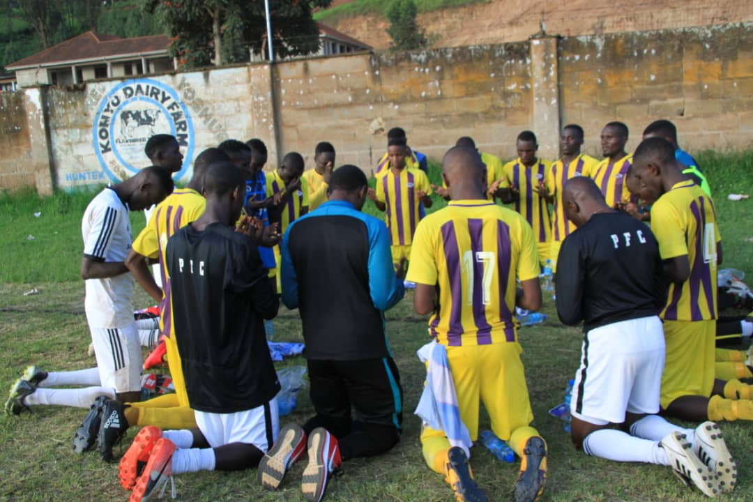 Proline players and technical staff during a bonding moment after securing promotion on Thursday. (Proline Photo)