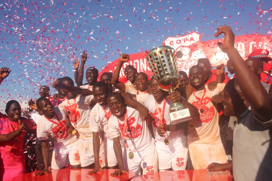 St. Mary's Kitende players celebrate winning the 2019 Copa Coca Cola Championships on Saturday. (PHOTO/AGENCY)