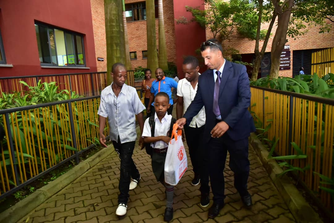 Fresh Kid  carrying scholastic Materials on his first day at  Kampala Parents school (PHOTO/ Abraham)
