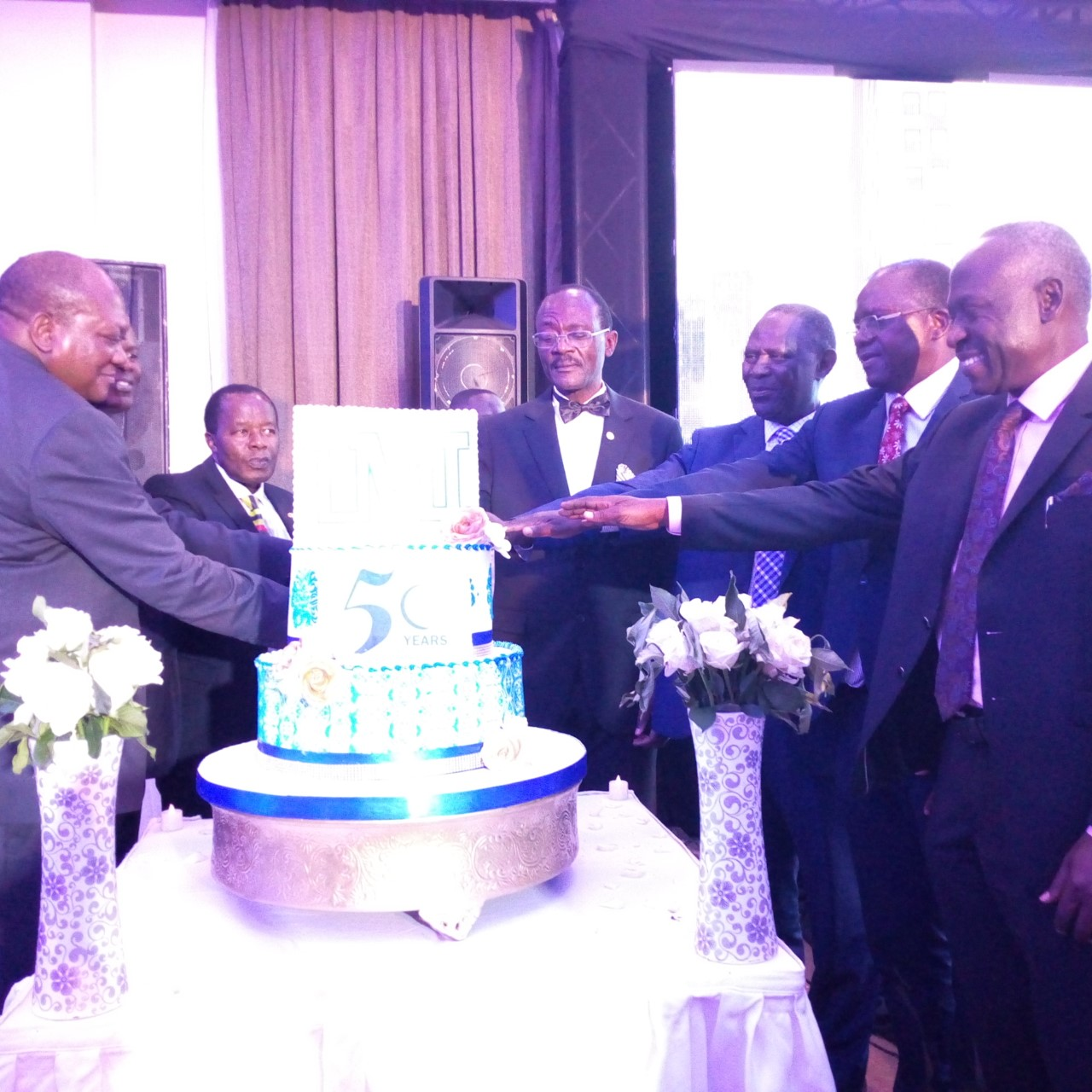 Uganda Management team and the delegates cut a cake at the Awards ceremony on Wednesday, May 29, at Protea Hotel (PHOTO/ Abraham MUTALYEBWA)