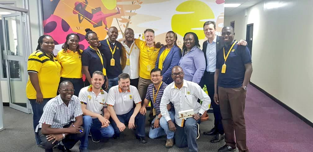 MTN staff celebrate the return of their deported boss
