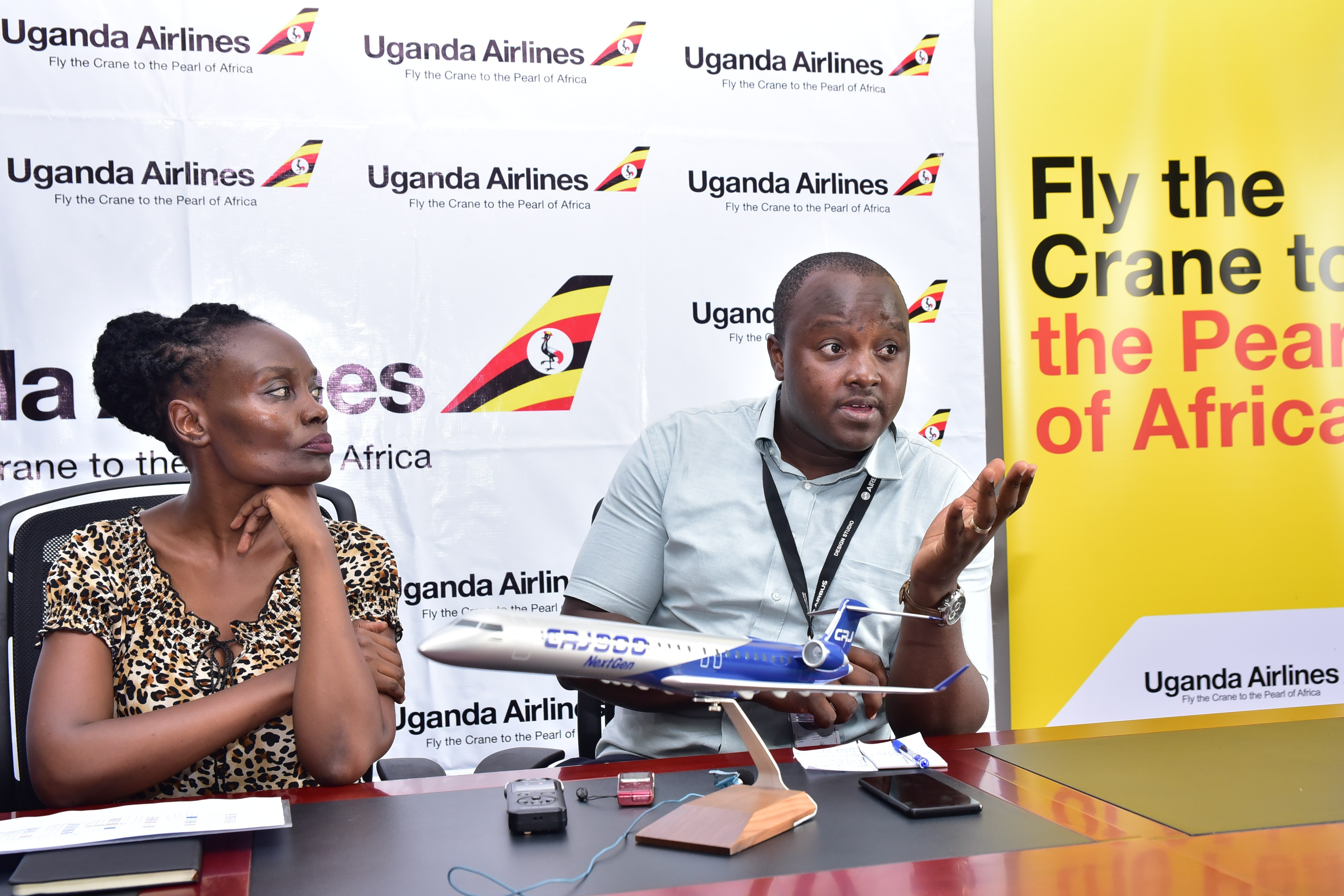 Uganda Airlines Director for finance, Jennifer Bamuturaki and Manager Quality Assurance Michael Kariisa speak to the press recently. (PHOTO/File)