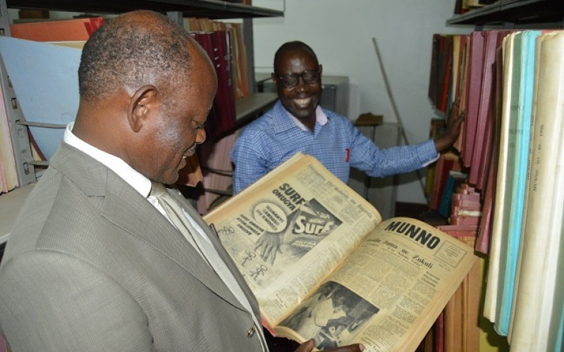 Prof. Barbanas Nawangwe looking at one of the Munno Publication that is archived in the Makerere University Library. (PHOTO/PML)