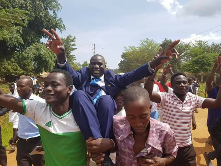 FDC's Onega Robert carried by his supporters after the Nebbi Court ruled nuligying the election of NRM's