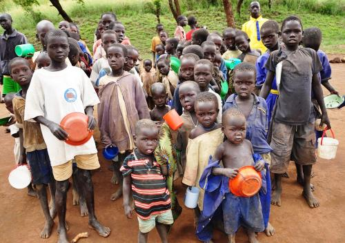Pupils at Kamion Primary school in IK land wait for lunch recently Kaabong district. World Bank urges Uganda to increase investment in education.