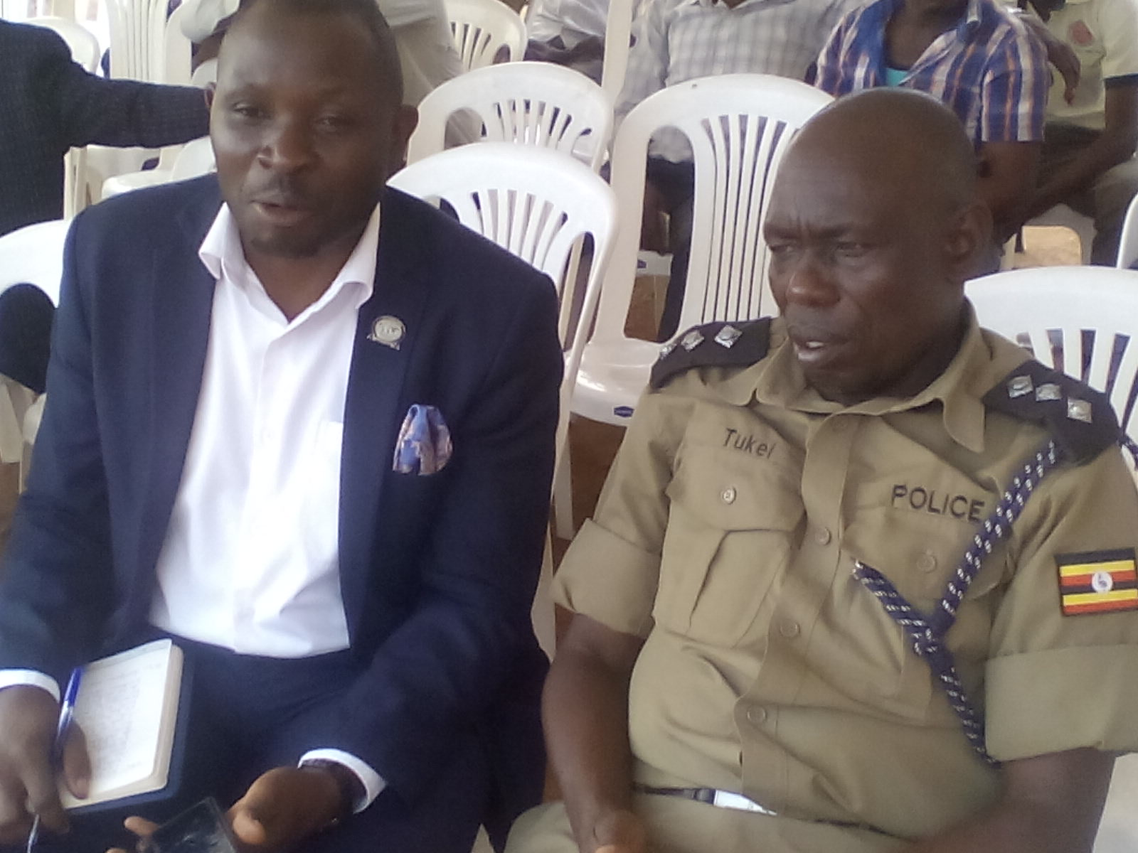 Sempala Robert from HRNJ is flanked by Elgon region Police spokesman John Robert Tukei.