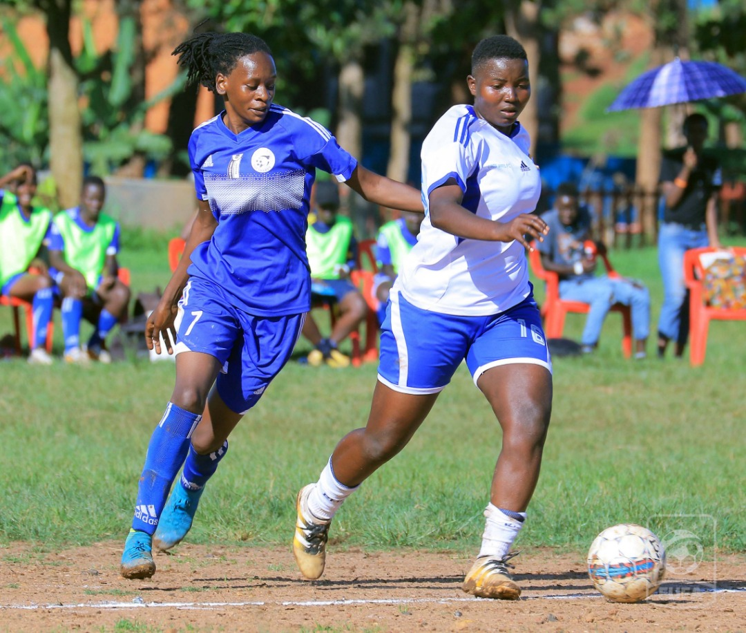 Lady Doves midfielder Margaret Agnes Kayima (Right) takes on Sarah Namulindwa (left) of She Corporates in the 2019 FUFA Women's Cup semi final.