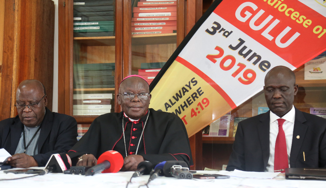 Archbishop Odama (C), flanked by the Secretary General Uganda Episcopal Conference Msgr. John B. Kauta (L), and Mr. Bradford Ochieng the deputy CEO, Uganda Tourism Board (R)  (PHOTO/Courtesy)