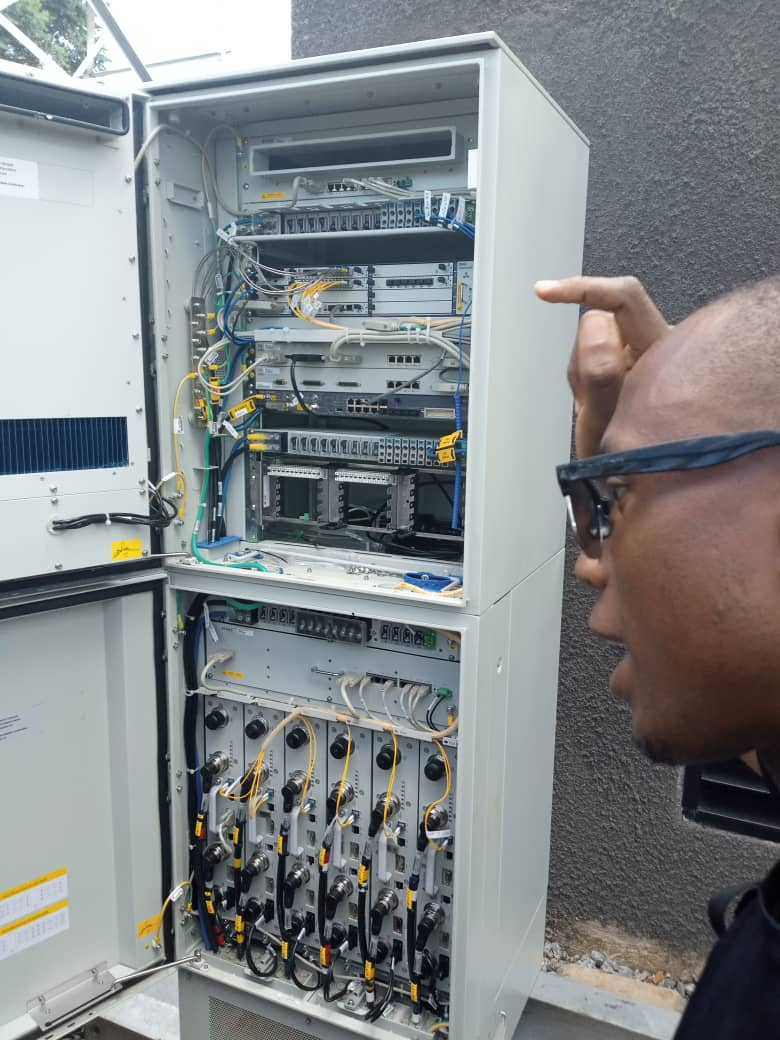 An MTN technician explains to RCDF and local leaders how the newly commissioned site will boost the connectivity in the region. (PHOTO/Javira Ssebwami)