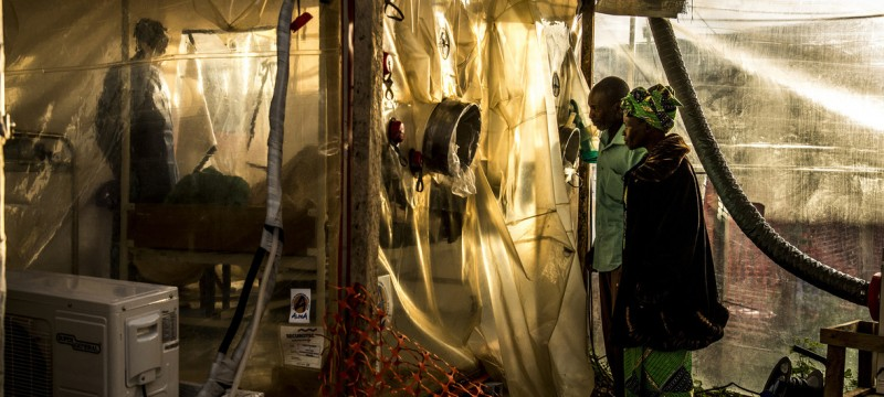 World Bank /Vincent Tremeau Parents visiting her 15-year-old daugher, who is suspected of being infected by Ebola, at the Ebola Treatment Center in Beni, DRC (January 2019). (PHOTO/Courtesy)