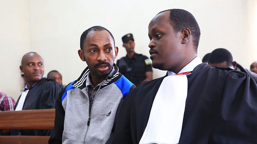 Callixte Nsabimana and his lawyer Moise Nkundabarashi in Court. (PHOTO/Courtesy)