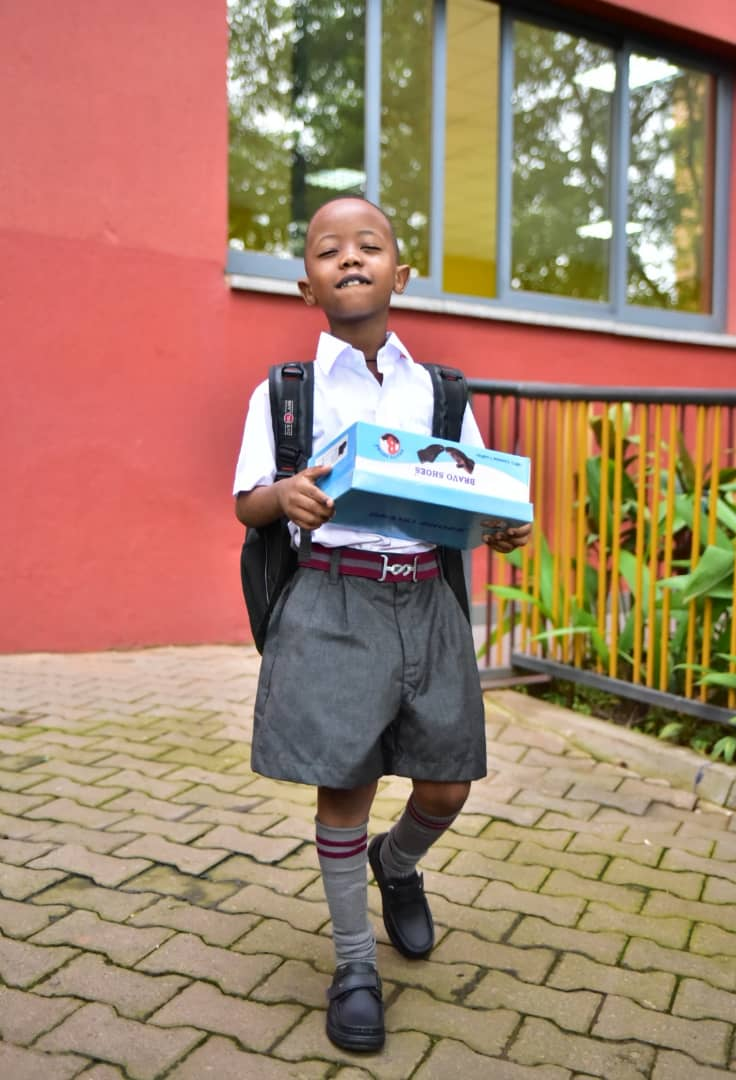 Fresh Kid  carrying scholastic Materials on his first day at  Kampala Parents school (PHOTO/Abraham)