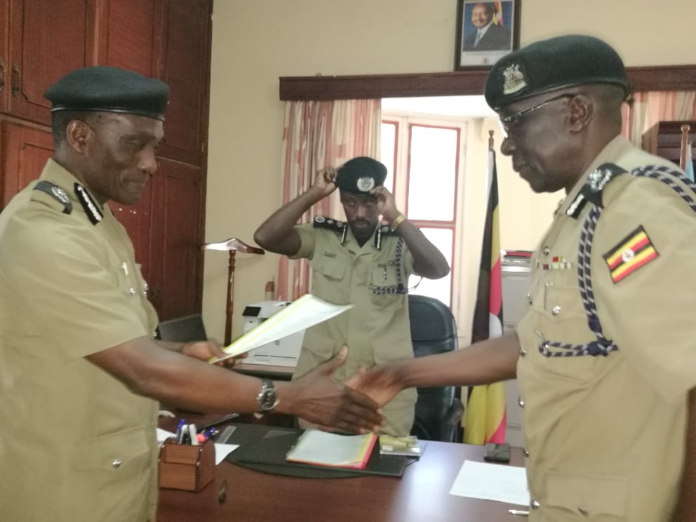 AIGP Fred Yiga handed over office to his deputy SCP Benson Oyo-Nyeko.