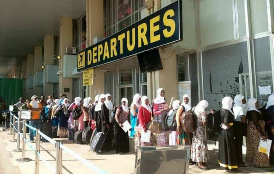 A group of Ugandans at Entebbe International Airport departures heading to the UAE for work. Government has susspended the