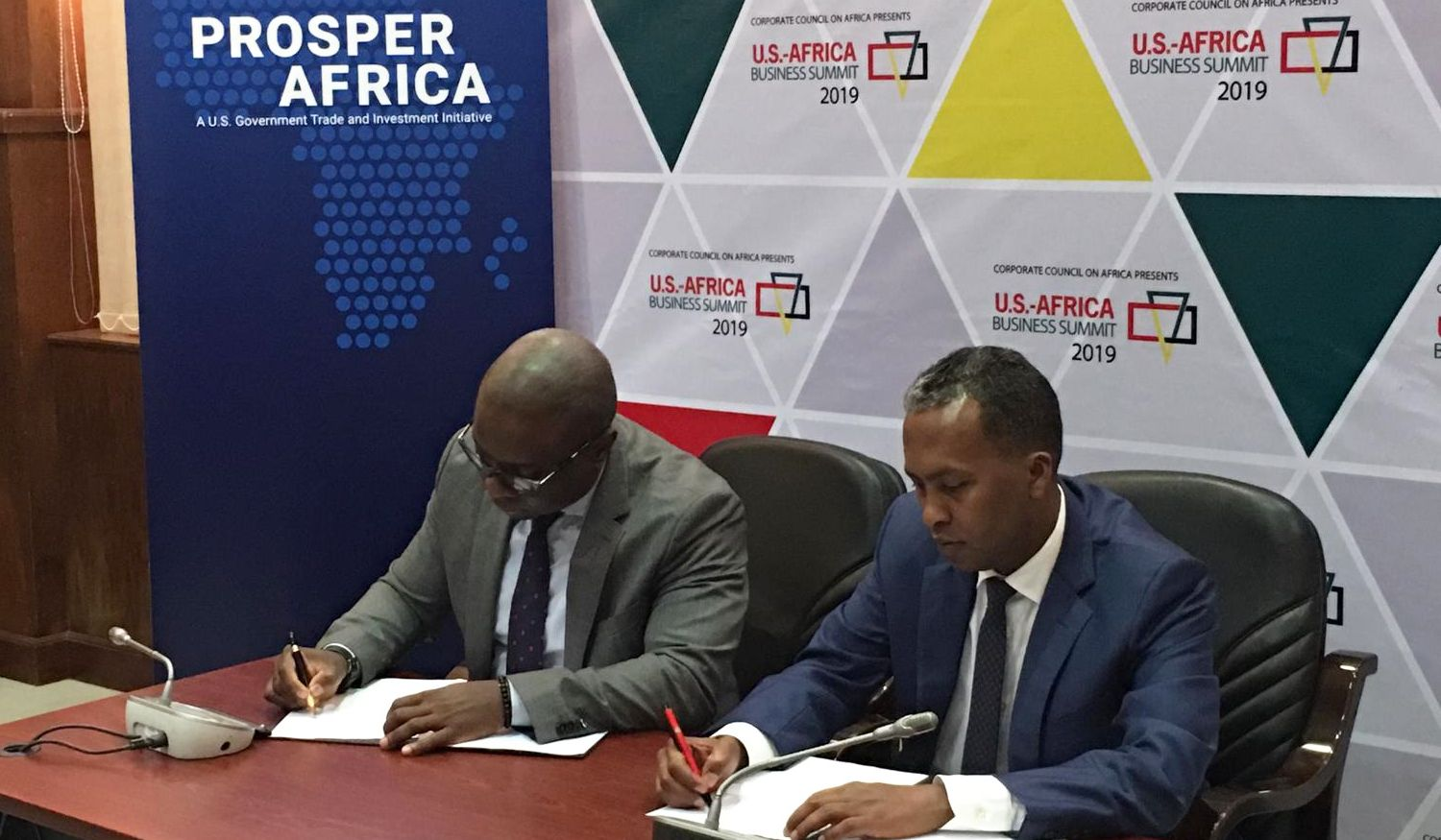 AGCO Africa and AT Capital bosses signing MoU