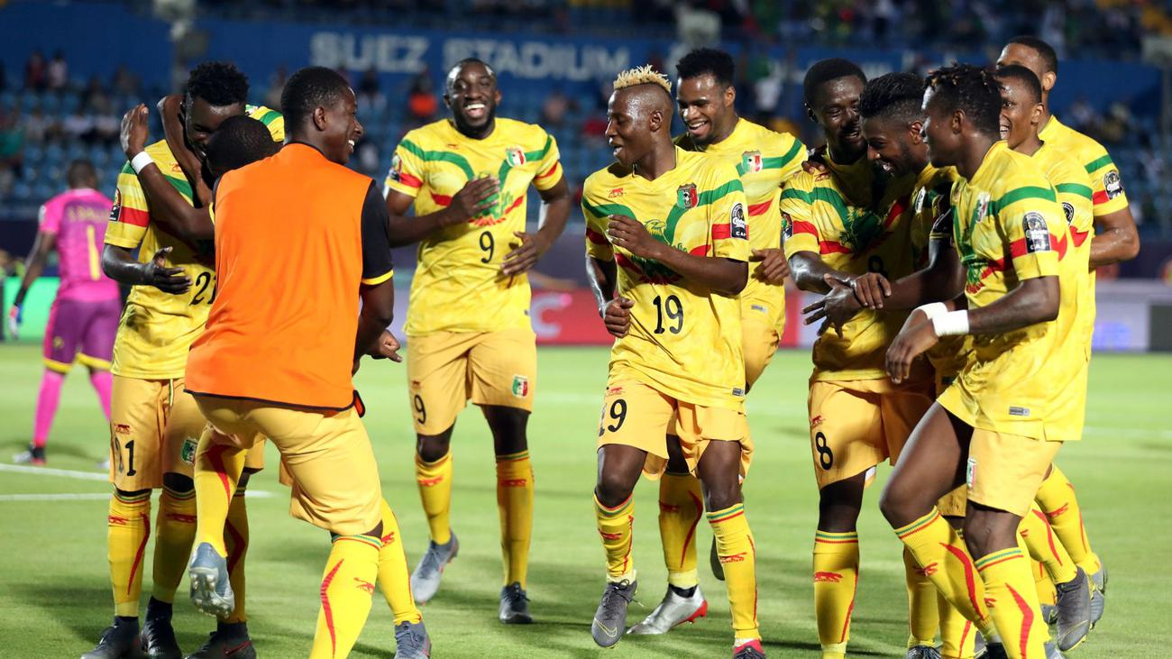 Mali players celebrate on of their four goals against Mauritania on Monday. (PHOTOS/Agencies)