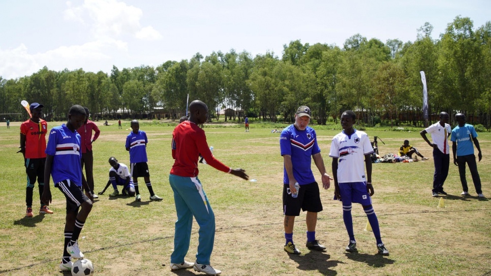 Training session with Italian Sampdoria coach Marco Bracco who is explaining an exercise to the boys selected from among refugees and the host community.  (PHOTO/UNHCR)