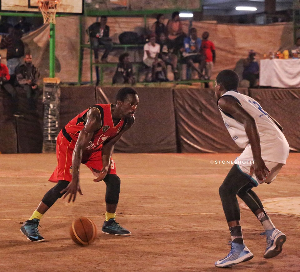 Warriors' Chris Omanyi (left) in action against Ndejje on Sunday. (PHOTOS/FUBA)