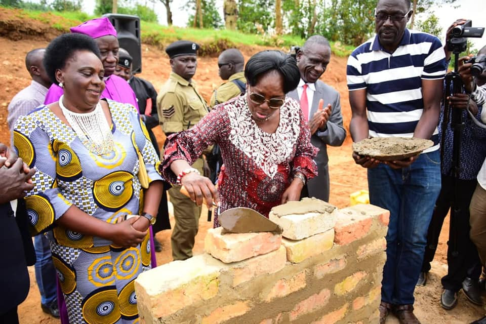 Ms. Kadaga laying a foundation for the construction of the Reusable sanitary towel factory
