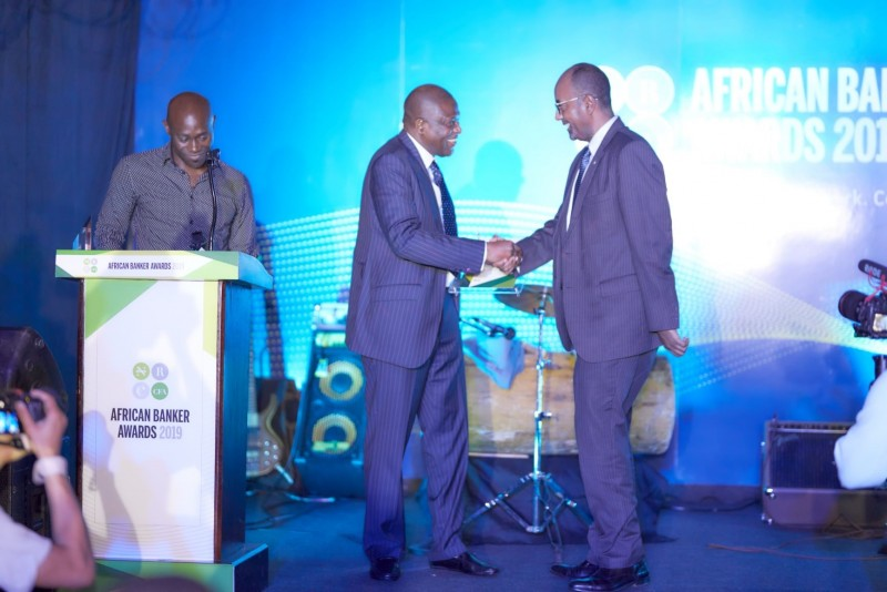 African Banker of the Year, Admassu Tadesse receiving the award from Olukayode Pitan, MD, Bank of Industry. (PHOTO/Courtesy)