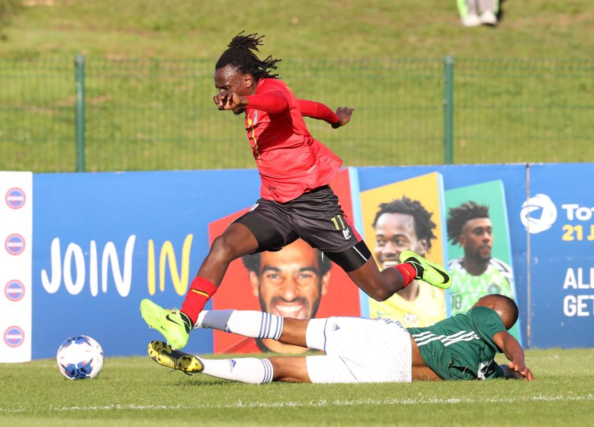 Michael Birungi beats a Lesotho defender on Saturday. (PHOTOS/FUFA)