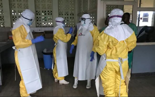 A team from Doctors Without Borders (MSF) don protective clothing and equipment as they prepare to treat Ebola patients in an isolation ward (PHOTO/File)