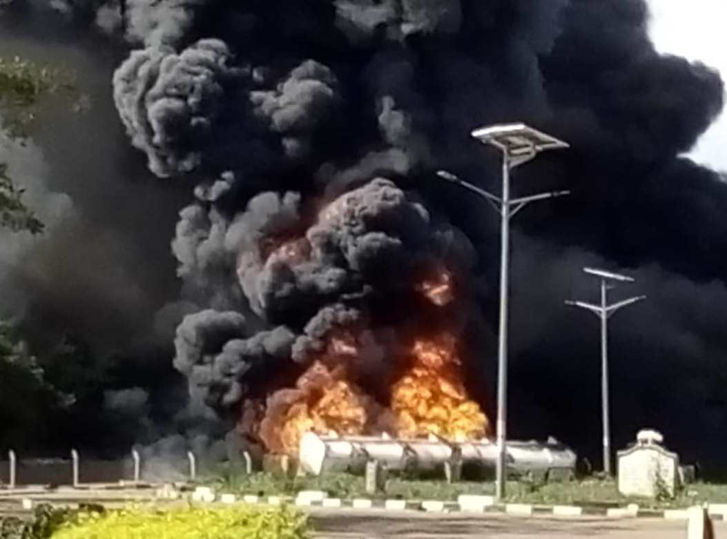 A view of the fuel-tanker on fire as the fire brigade and Police try to put it out. (PHOTO/Courtesy)