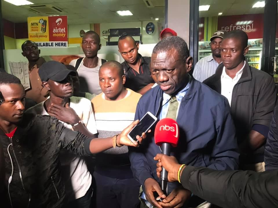 Properiotor of Total Petro station Nsambya, also opposition lynch pin, Dr. Kizza Besigye speaks to the  Press after the incident. (PHOTO/File)
