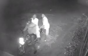 The two unidentified thugs embark on the killing of the boda boda cyclist before making off with his motorcycle. (PHOTO/CCTV)