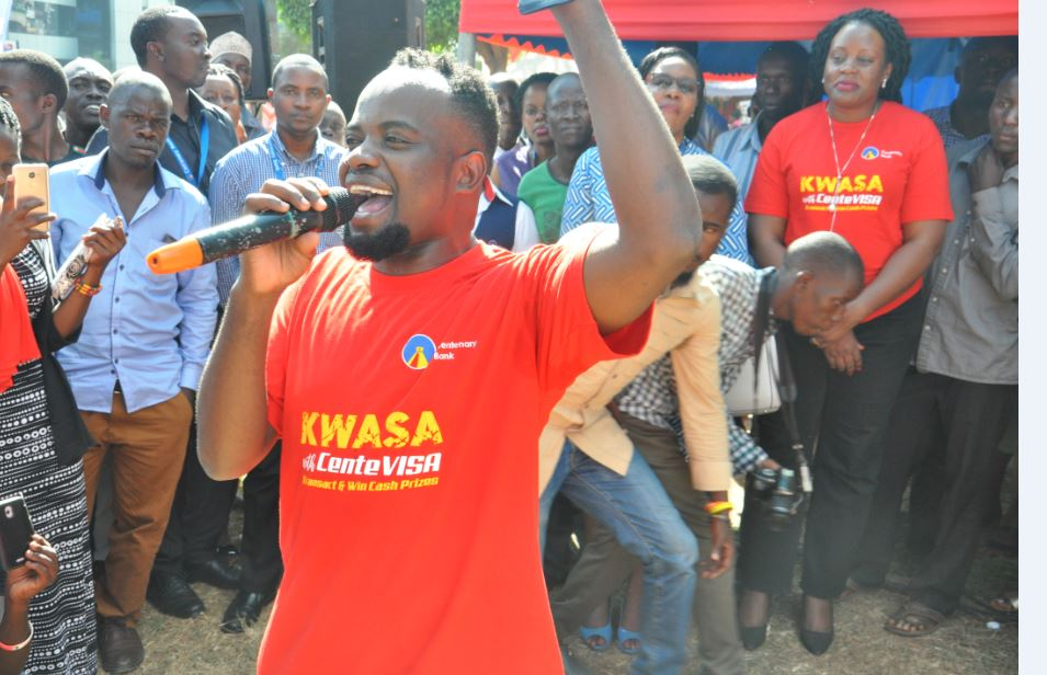 David Lutalo, the 'Kwasa with CenteVisa' campaign ambassador, entertains customers at campaign launch. (PHOTO/Courtesy)