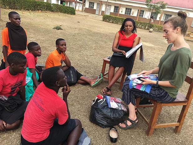 American woman - Mara Harvard along with BDP staff interpretors Sara, provides much needed health information to Ugandan school girls while distributing the Days for Girls reusable Menstruation kits. (PHOTO/Courtesy)