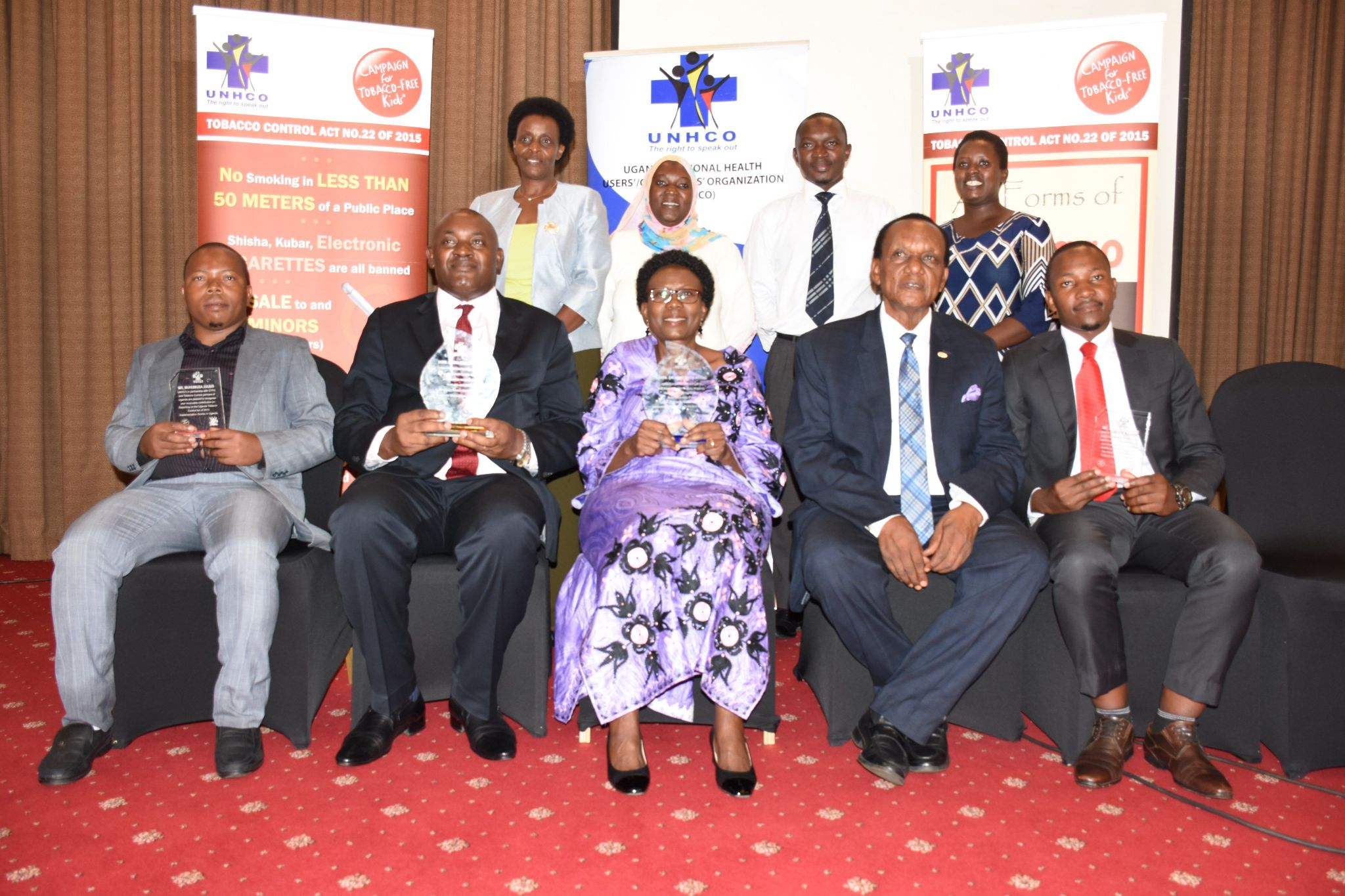 Ministers Dr Ruth Aceng (front centre), Dr Chris Baryomunsi (2nd L) and other award recipients.