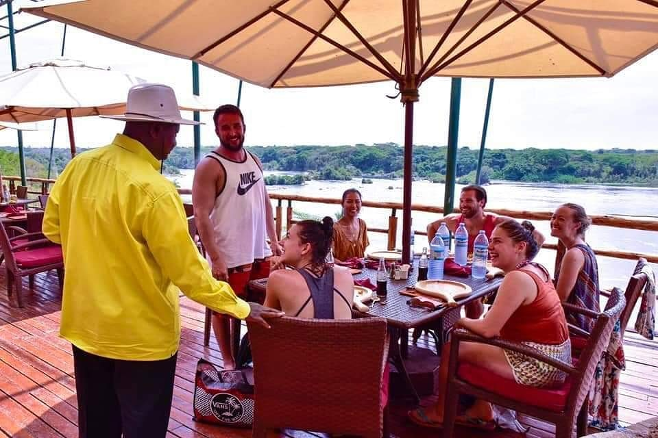 Museveni with tourists at Murchison falls National park