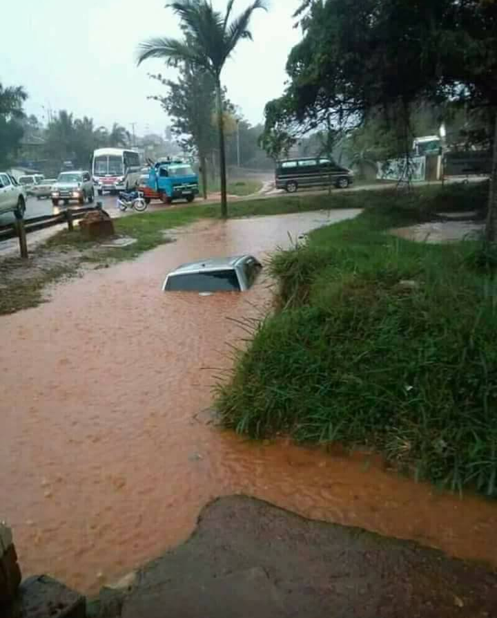 Have rains have swept three cars at a washing bay in Kampala. (PHOTO/Courtesy)