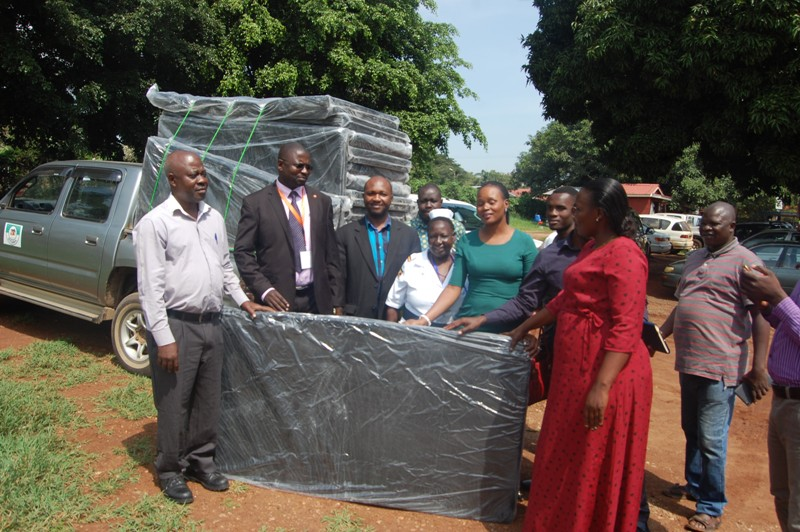 Tororo district leaders and the administration of Tororo district referral hospital display mattresses donated by Tororo cement Industries Limited. Photo by Joseph Omollo.