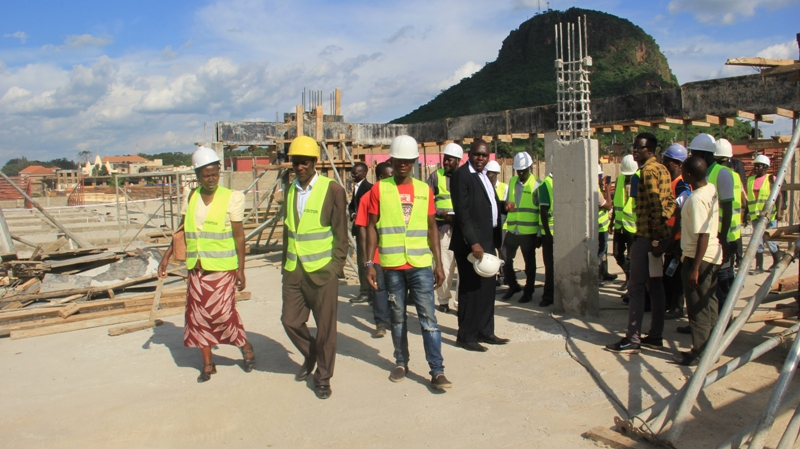 Tororo municipal council leaders inspect the ongoing construction at the Tororo central modern market after a site meeting. Photo by Joseph Omollo
