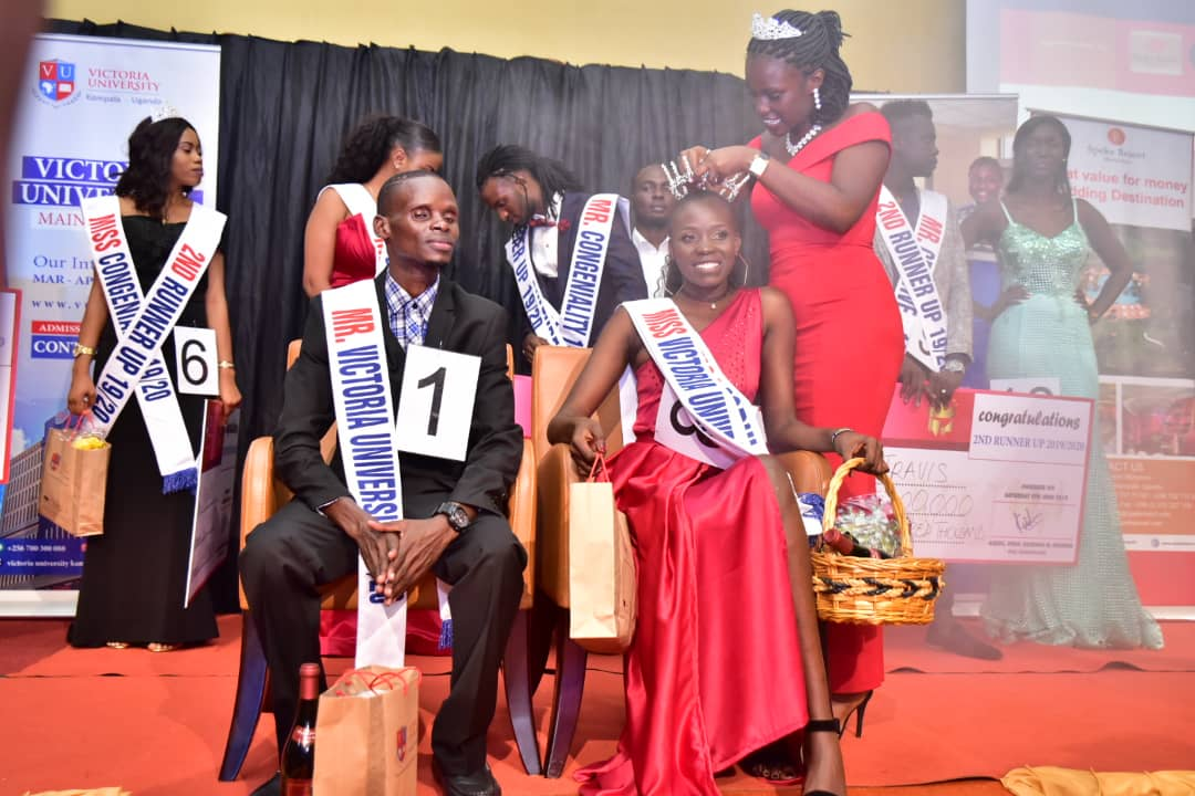 Robert Ssekamaanya and Nhial Achan Bol being crowned as Mr and Miss Victoria University at the grandfinale of the pageant held at Speke Resort Munyonyo Saturday June 8, (PHOTO/PML Daily)