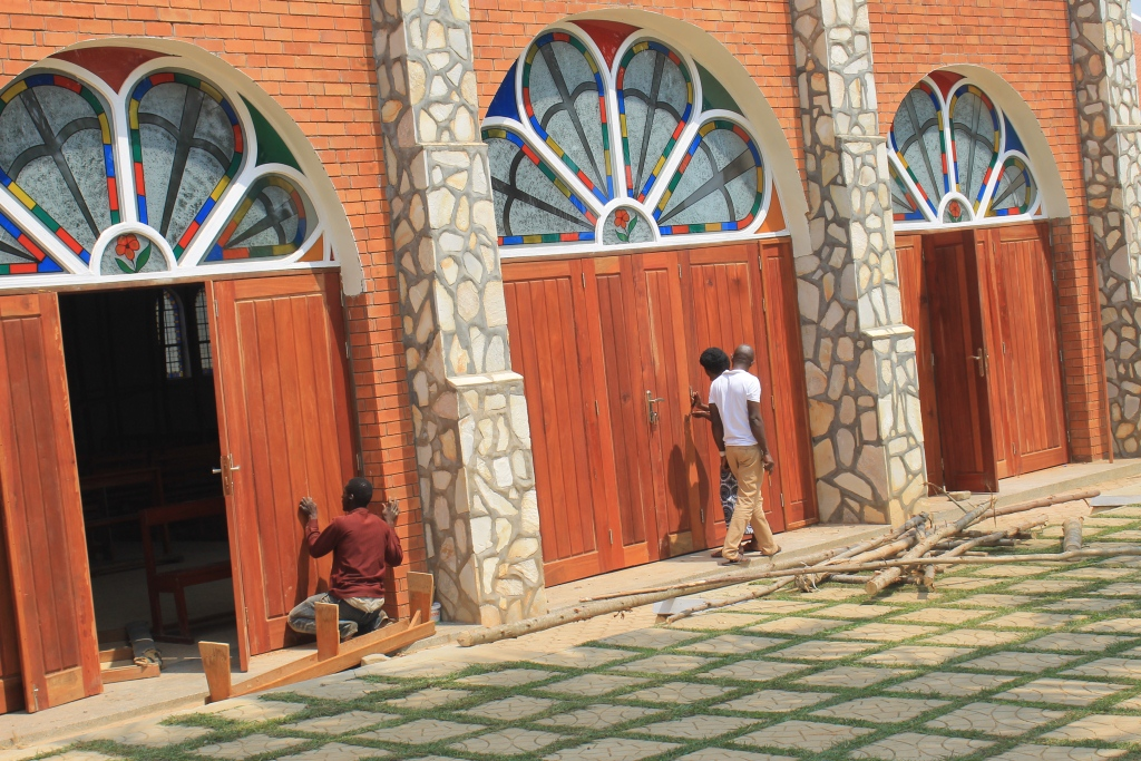 Workers furnishing the doors of the newly rennovated church (2)