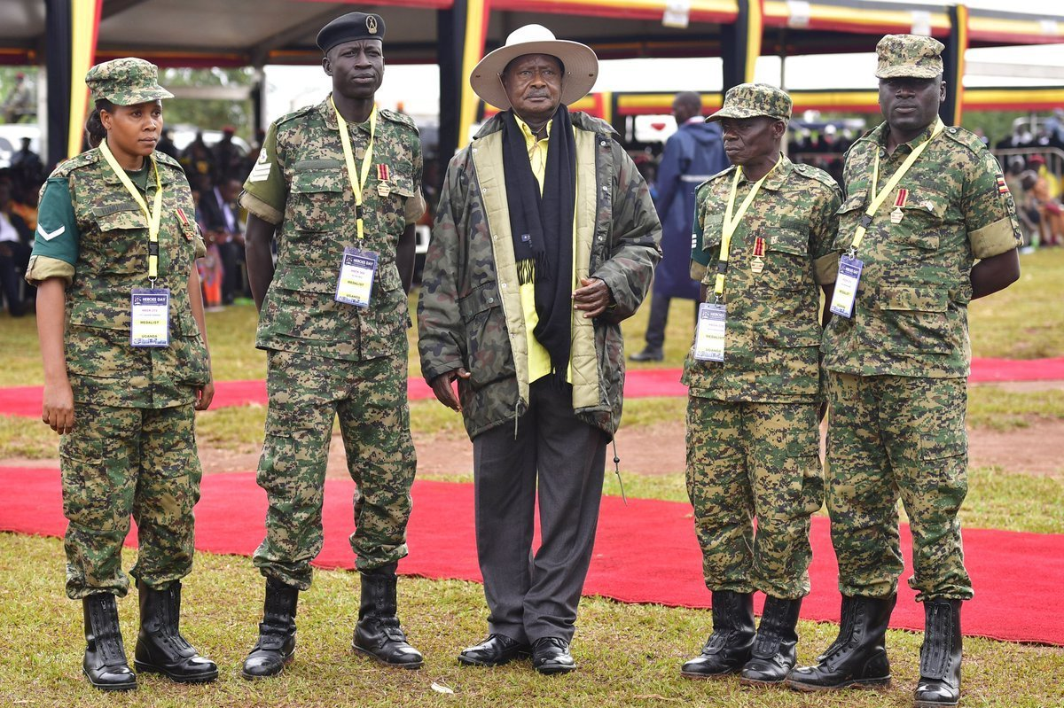President Museveni with some of the soldiers he awarded medals