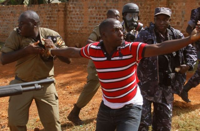 Former security aides to ex-Premier Amama Mbabazi, Aine Christopher (in stripped red Polo tshirt) has gone bareknuckled on President Museveni slapping him with 15 day ultimatum. (PHOTO/File)