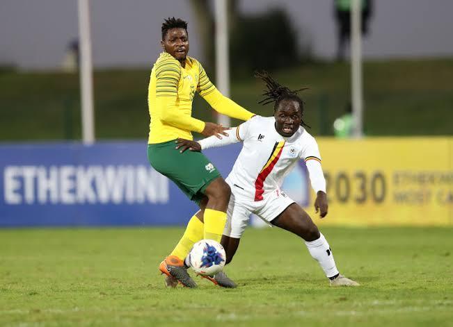 Sserunkuma (R) scored Uganda's only goal in South Africa.