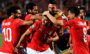 Egyptian players celebrate Trazeguet's winner on Friday. (PHOTOS/Agencies)