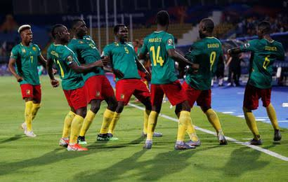 The Cameroon players celebrate their second goal against Guinea-Bissau on Tuesday. (PHOTOS/Agencies)