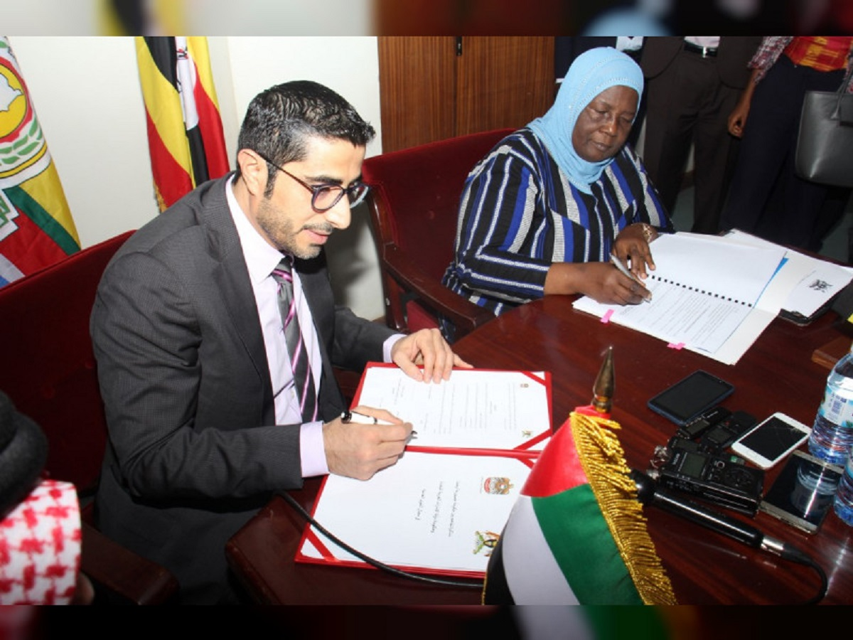 Gender and labour minister Janat Mukwaya and UAE official at the signing in Kampala. (PHOTO/PML)