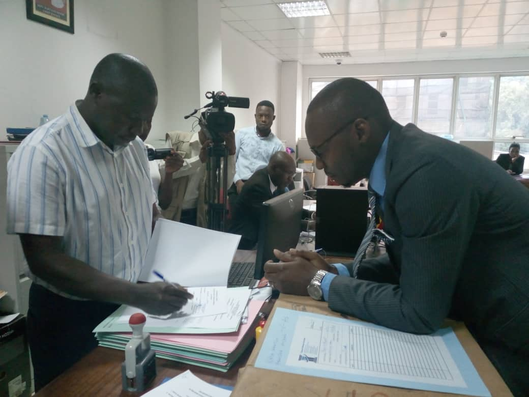 Mr Michael Aboneka in the High Court registry filing his case. Photo By Rachel Agaba
