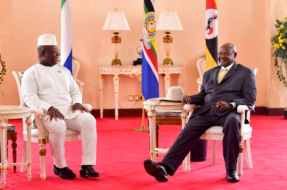 President Museveni (R) and