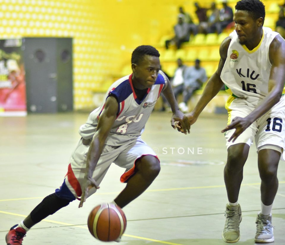 UCU Canons' Fayed Baale (8) tries to dribble past Oscar Muge of KIU on Friday at MTN Arena. (PHOTOS/FUBA)